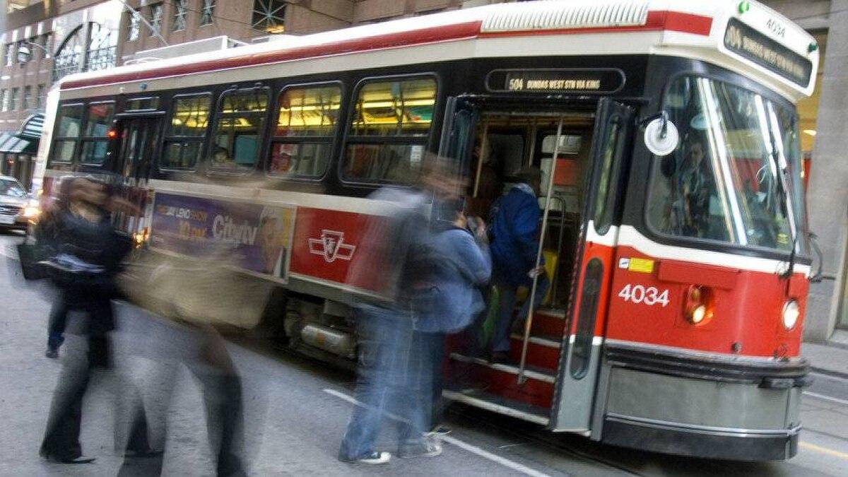 A TTC streetcar takes on passengers in Toronto on Nov. 17, 2009.
