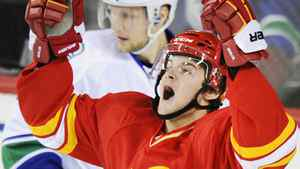 Calgary Flames' Roman Horak celebrates his goal against the Vancouver Canucks as Alexander Edler looks at the puck in the net during the second period of their NHL hockey game in Calgary, Alberta February 11, 2012. REUTERS/Mike Sturk