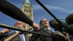 NDP leadership candidate Brian Topp speaks to reporters in front of the Peace Tower on Sept. 23, 2011.