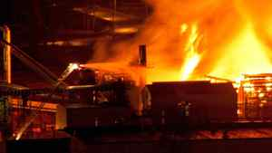 Firefighters direct water at a large fire burning at the Lakeland Mills sawmill in Prince George, B.C., on Tuesday April 24, 2012.