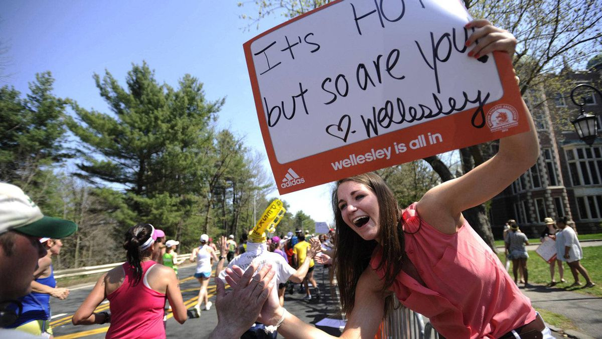 Wellesley College Sophomore Valerie Ludorf, of Hopkinton, Mass., cheers for the runners along the route of the 116th Marathon in Wellesley, Massachusetts April 16, 2012. REUTERS/Gretchen Ertl (UNITED STATES - Tags: SPORT ATHLETICS)