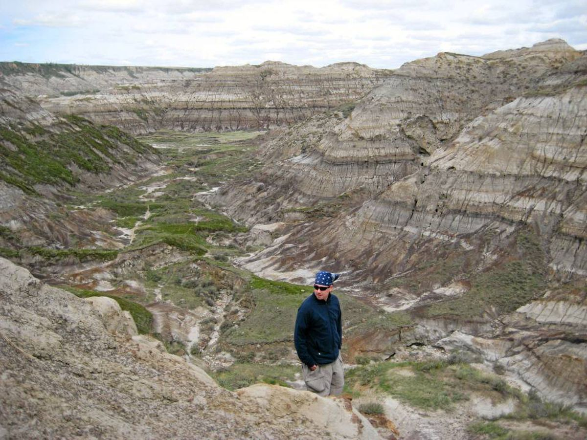 Hiker Paul Haavardsrud studies some of the fragmented rock on the steep incline out of Horsethief Canyon north of Drumheller, Alta.