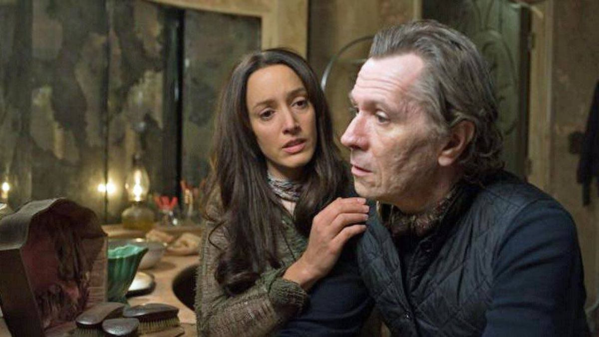 Gary Oldman as Carnegie (right), with Jennifer Beals in The Book of Eli (2010).