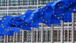 European Union flags are seen outside the European Commission headquarters in Brussels.
