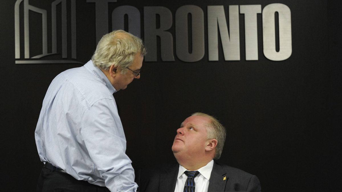 Mayor Rob Ford confers with his budget chief Mike del Grande during a committee hearing on Jan 24.