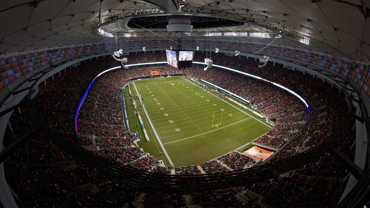 The B.C. Lions and Edmonton Eskimos play with the roof open at the renovated B.C. Place stadium during the first half of a CFL football game in Vancouver, B.C., on Friday September 30, 2011.