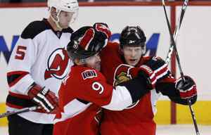 Ottawa Senators centre Jason Spezza, right, celebrates his goal against the New Jersey Devils with teammate Shean Donovan during the first period of their NHL hockey game in Ottawa, January 26, 2010.