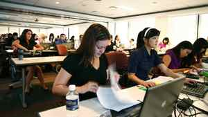 Ernst & Young employees attend a training session at the company's Toronto offices.
