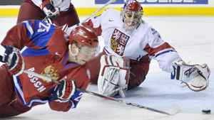 Russia forward Yevgeni Kuznetsov, left, gets stoned by Czech Republic goalie Petr Mrazek, right, during first period quarter final IIHF World Junior Championships hockey action in Calgary, Alta., on Monday, Jan. 02, 2012. THE CANADIAN PRESS/Nathan Denette