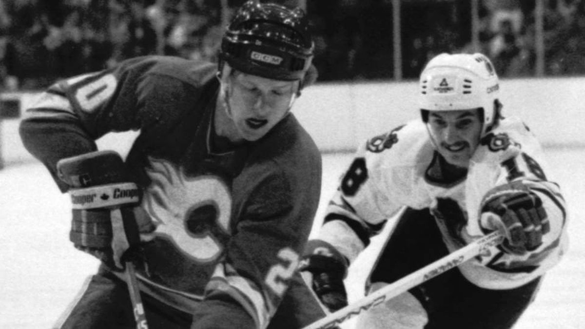 n this February 1986 file photo, Calgary Flames' Gary Suter, left, controls the puck as Chicago Blackhawks' Denis Savard attempts to close in during an NHL hockey game in Chicago.