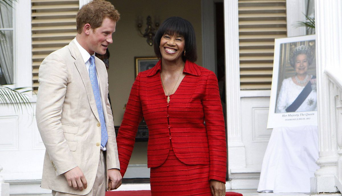 Prince Harry meets Jamaica's Prime Minister Portia Simpson Miller at Devon House in Kingston March 6, 2012.