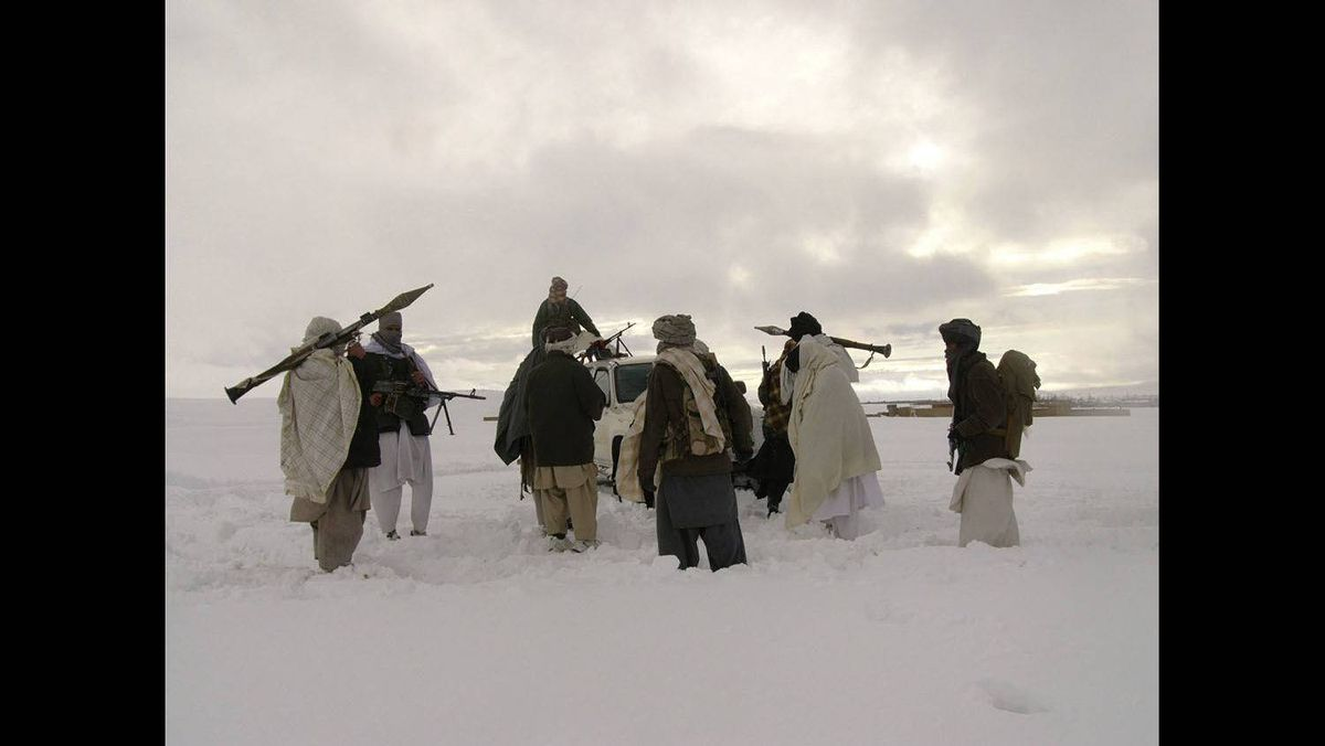 In this file picture released exclusively to Reuters on January 17, 2009, Taliban militants are seen with their weapons in an undisclosed location in Afghanistan on January 16, 2009.