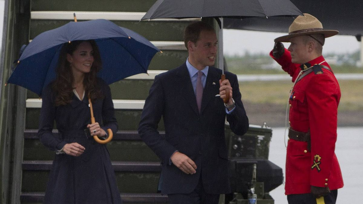 The Duke and Duchess of Cambridge are saluted by a RCMP as they arrive in Yellowknife, N.T. during their tour of Canada on Monday July 4, 2011.