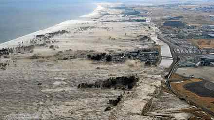 A massive tsunami hits the coastal areas of Iwanuma, Miyagi Prefecture, northeastern Japan, March 11, 2011.