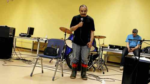 Leo (Kallu Nangmalik, 50) speaks to the people gathered in the community center in Repulse Bay, Nunavut (on the Arctic Circle) on the evening of November 13, 2010. Following a day of group therapy by a men's support group, they held a healing service open to all members of the community in the Community Centre. There were prayers, music and tears as men shared their pain openly and made amends with family members, and people came forward to be healed.