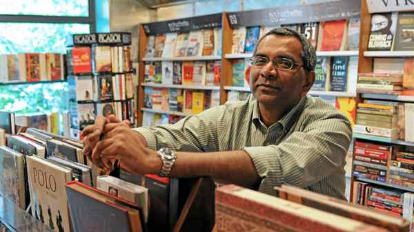David Davidar, author and publisher, photographed at The Book Shop his father-in-law's book store in New Delhi.