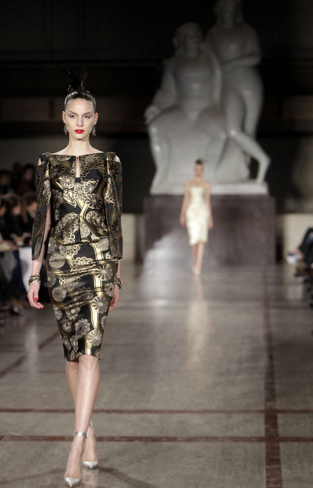 Like Jason Wu, Zac Posen also looked to Asia for inspiration, incorporating origami folds into dress backs and imperial Chinese motifs on dramatic dresses. Often though, the shorter skirts were too constricting and the mermaid hemlines much too much.