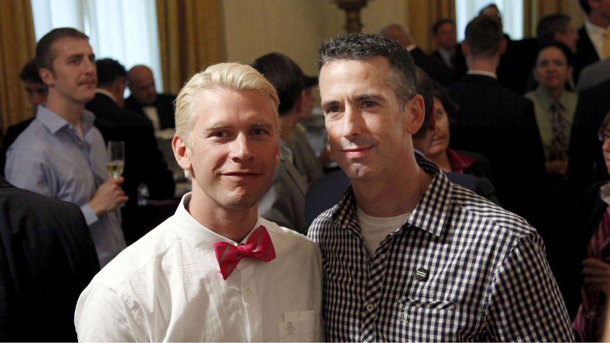 Gay activist and columnist Dan Savage, right, poses for a photo with his husband, Terry Miller, at an LGBT Pride Month event on June 29, 2011, at the White House. The couple's marriage has been thrown into doubt by Ottawa's reversal on same-sex marriage.