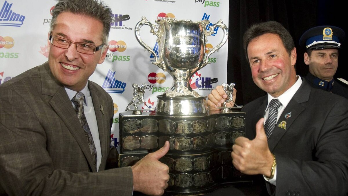 Shawinigan Cataractes president Real Breton, left, and Shawinigan Mayor Michel Angers pose with the trophy after winning the bid to hold the 2012 Memorial Cup