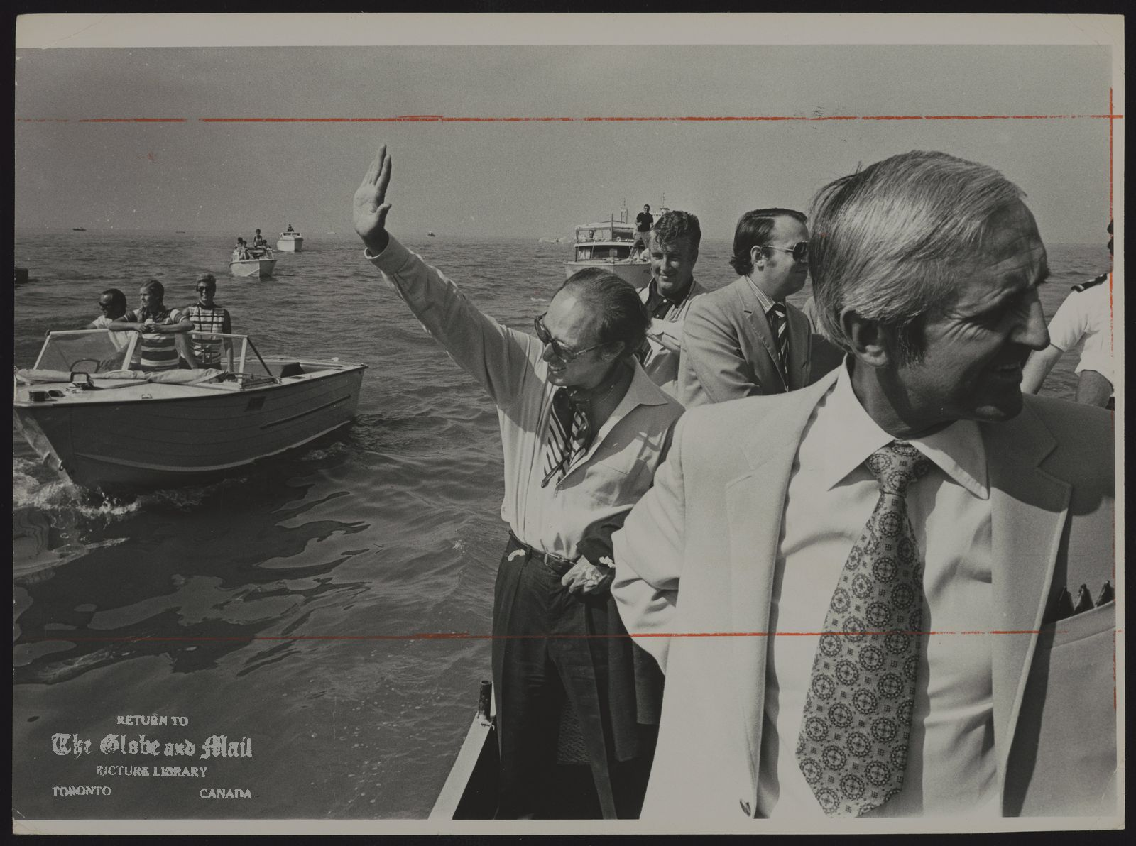 Pierre TRUDEAU Montreal. Politician On his way to World Rowing Championships in St. Catharines yesterday, Prime Minister Pierre Trudeau waves to pleasure boaters near Port Dalhousie after leaving the Coast Guard icebreaker Griffon. Energy and Resources Minister J.J. Greene is in, the foreground. They boarded the Griffon in Toronto.-- Dick Beddoes column, Page 22