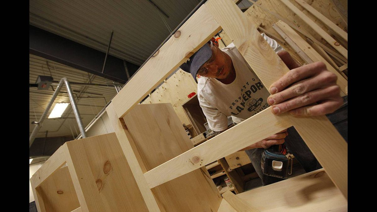 Vokes Furniture cabinet maker Cliff Price assembles a cabinet at the company's factory in Shallow Lake, Ont.