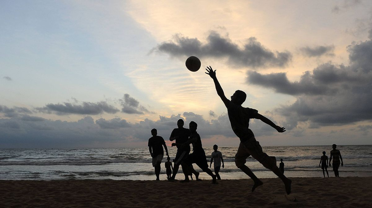 Sri Lankan youth play Rugby on a beach in Colombo on September 27, 2011. Widely known as the Pearl of the Indian Ocean, the island of Sri Lanka is endowed with over a thousand miles of golden beaches.
