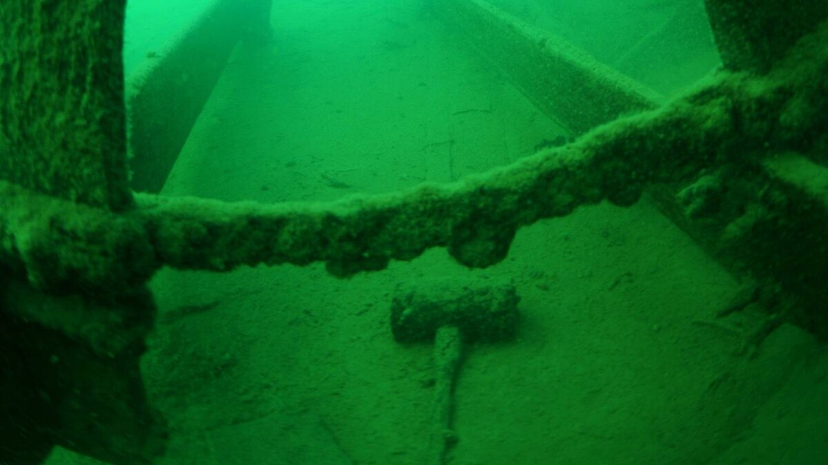 A wooden mallet from the Goddard engineer's tool box lies on the lake bed beneath the steamer's paddlewheel. Donnie Reid