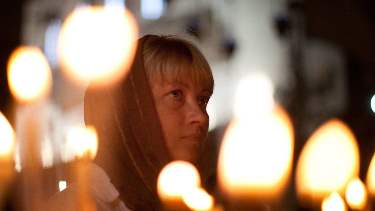 A woman looks on as she prays in the Church of the Nativity on December 22, 2011 in Bethlehem, West Bank.