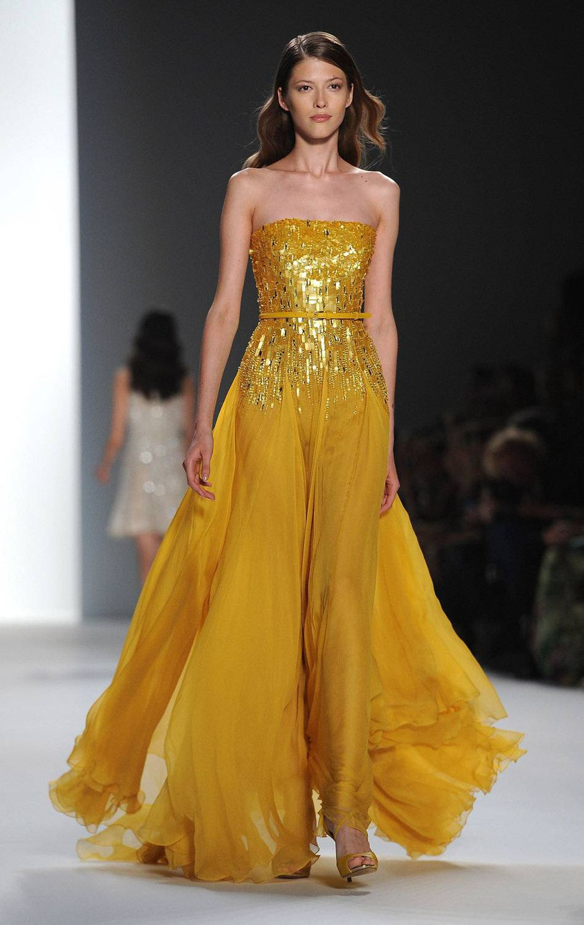 A model presents a creation by Lebanese designer Elie Saab as part of his spring/summer 2012 women's ready-to-wear fashion collection show in Paris, October 5, 2011.