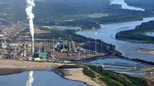 Suncor Canada's oil-sands upgrader facility sits on the banks of Alberta's Athabasca River in July of 2006.