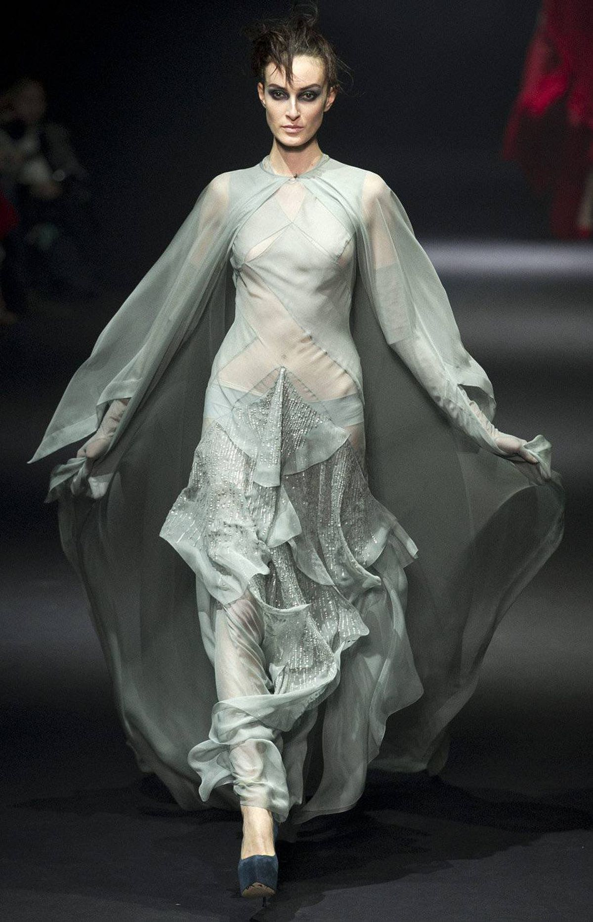 Gaytten continued the Galliano tradition of barely there diaphanous gowns cut on the bias. His additional flourishes: diamond panelling and billowing capes.
