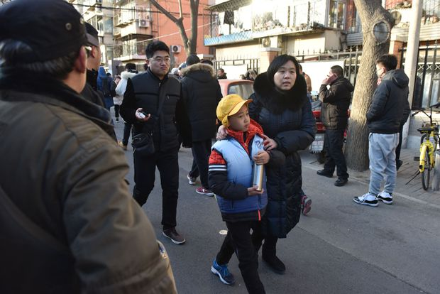 Beijing school attack: 20 children wounded by 'staff member'