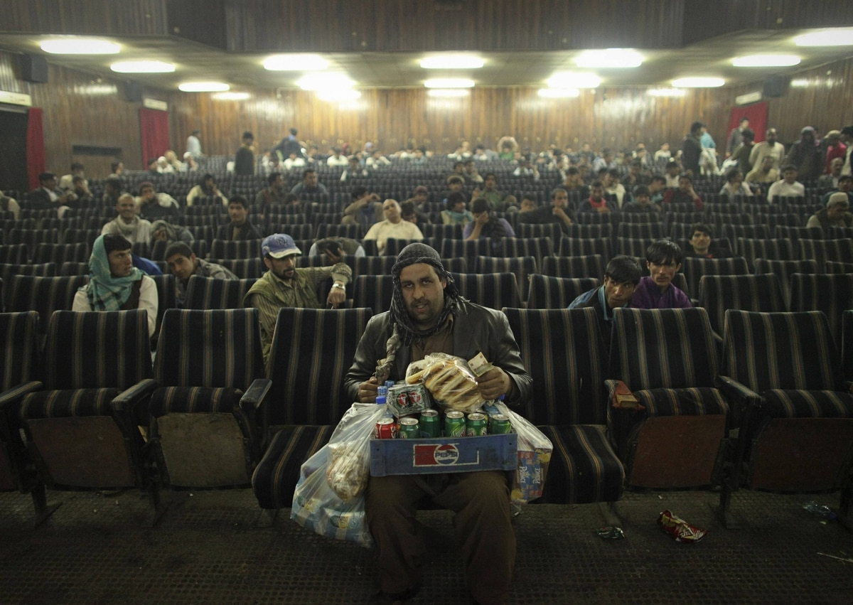 An employee of Cinema Pamir sells refreshments during the movie interval in Kabul.