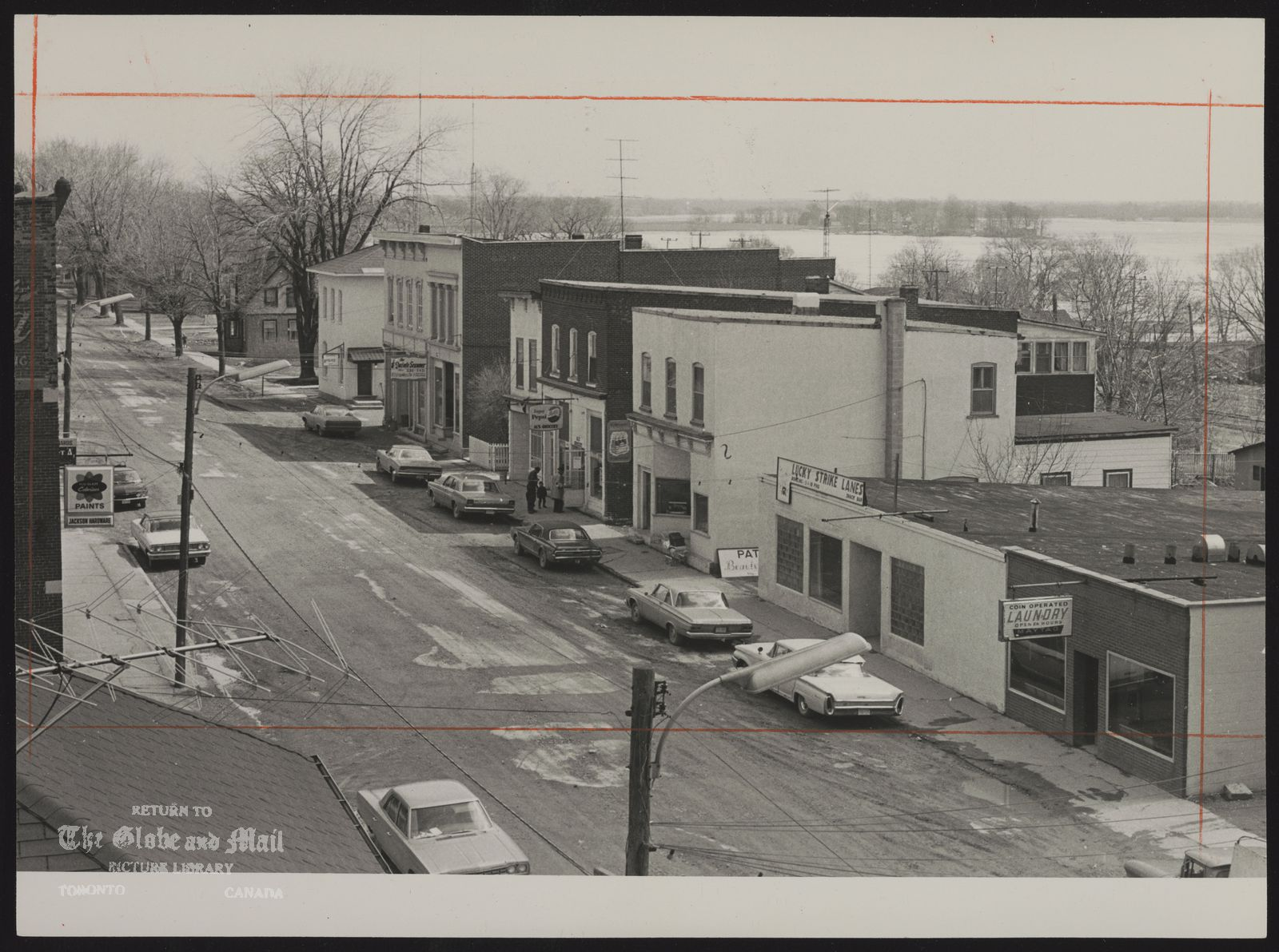 DESERONTO town (Ontario) (Deseronto's main street, with Bay of Quinte, town's source of water, in the background,)