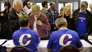 Supports line to get their pre-approved passes to a Conservative election rally in Hamilton on April 7, 2011.