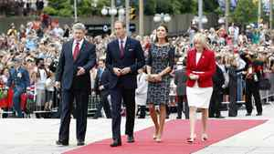 Canada's Prime Minister Stephen Harper (L) and his wife Laureen Harper (R) arrive alongside Britain's Prince William and his wife Catherine, Duchess of Cambridge at the National War Memorial in Ottawa June 30, 2011.
