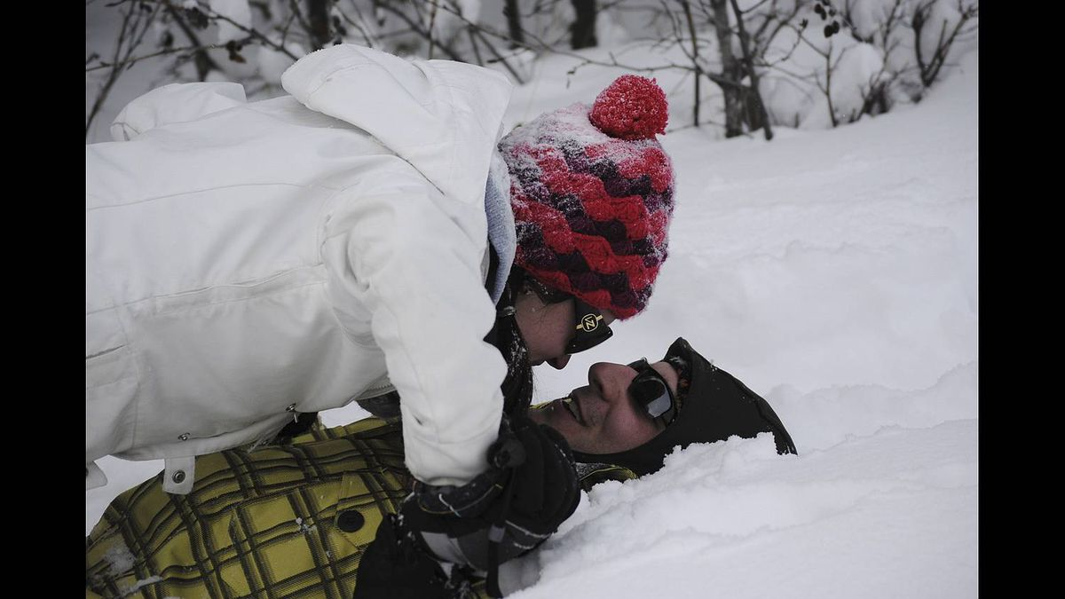 Barbara Baker photo: Relationships - Feb. 2011 - young love and a snowy take-down in Bragg Creek Alberta.