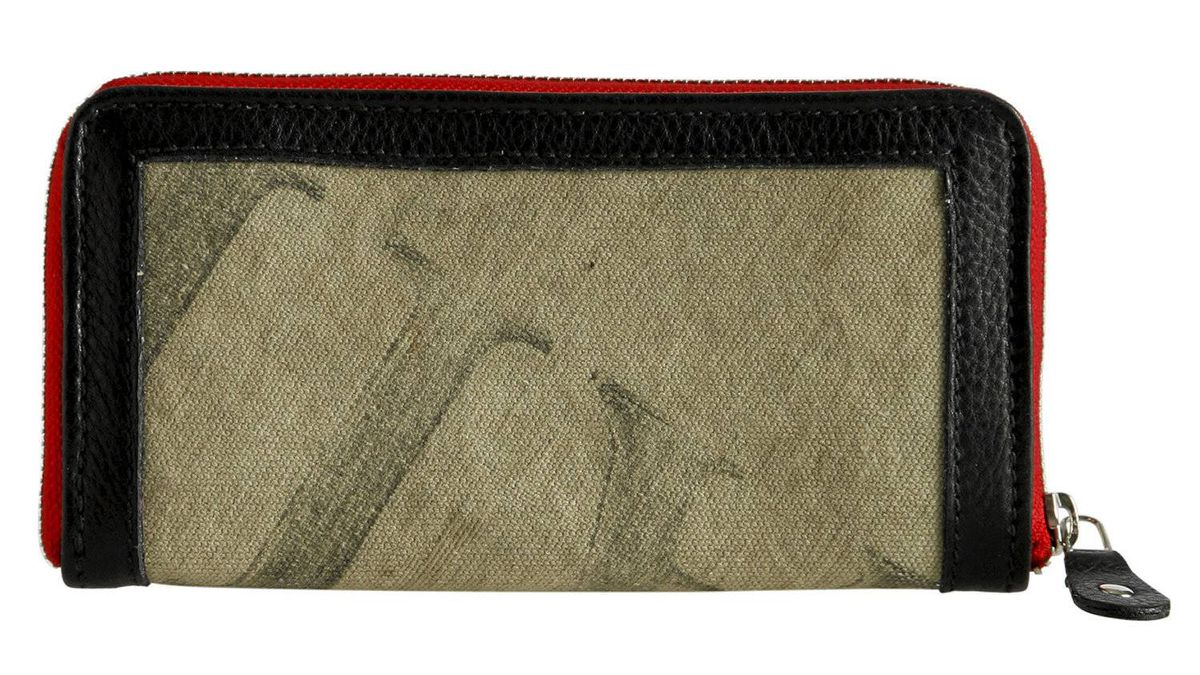 Reclaimed wallet With its weathered vintage look and nifty zip-around design, Roots Canada's trim wallet is a secure, eco-friendly stash for your cash. Handmade from reclaimed canvas once used in U.S. mail carrier bags, the sleek wallet is designed to keep everything safely zipped in. Its multiple interior compartments include 12 credit-card slots. $148; roots.com