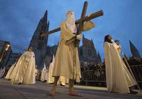 Penitents take part in the El Santo Entierro brotherhood procession during Holy Week in Burgos, northern Spain.