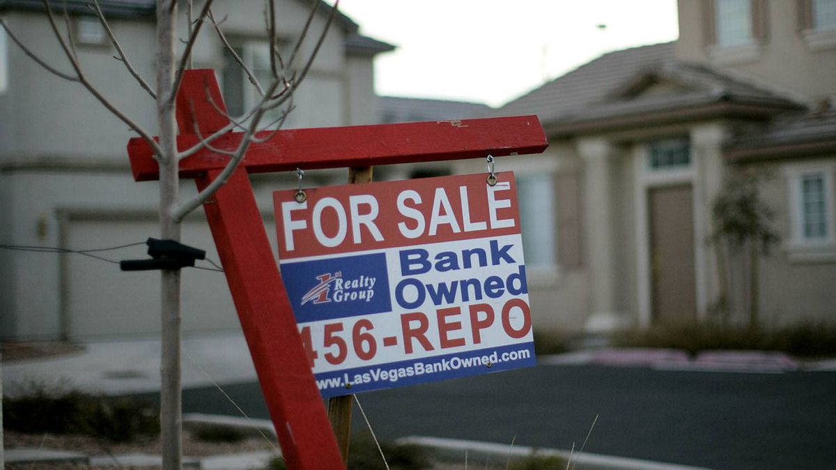 In this Feb. 8, 2008 file photo, a for sale sign stands in front of a bank-owned home in Las Vegas.