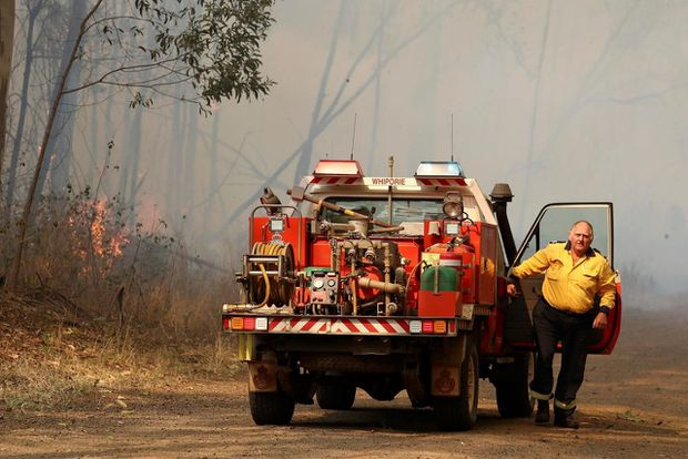 Out-of-control wildfires destroy up to 30 homes in eastern Australia