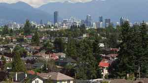 The skyline of Vancouver forms a backdrop for multi-million dollar homes in the Kitsilano and macKensie Heights neighbourhoods of Vancouver, BC August 3, 2011.