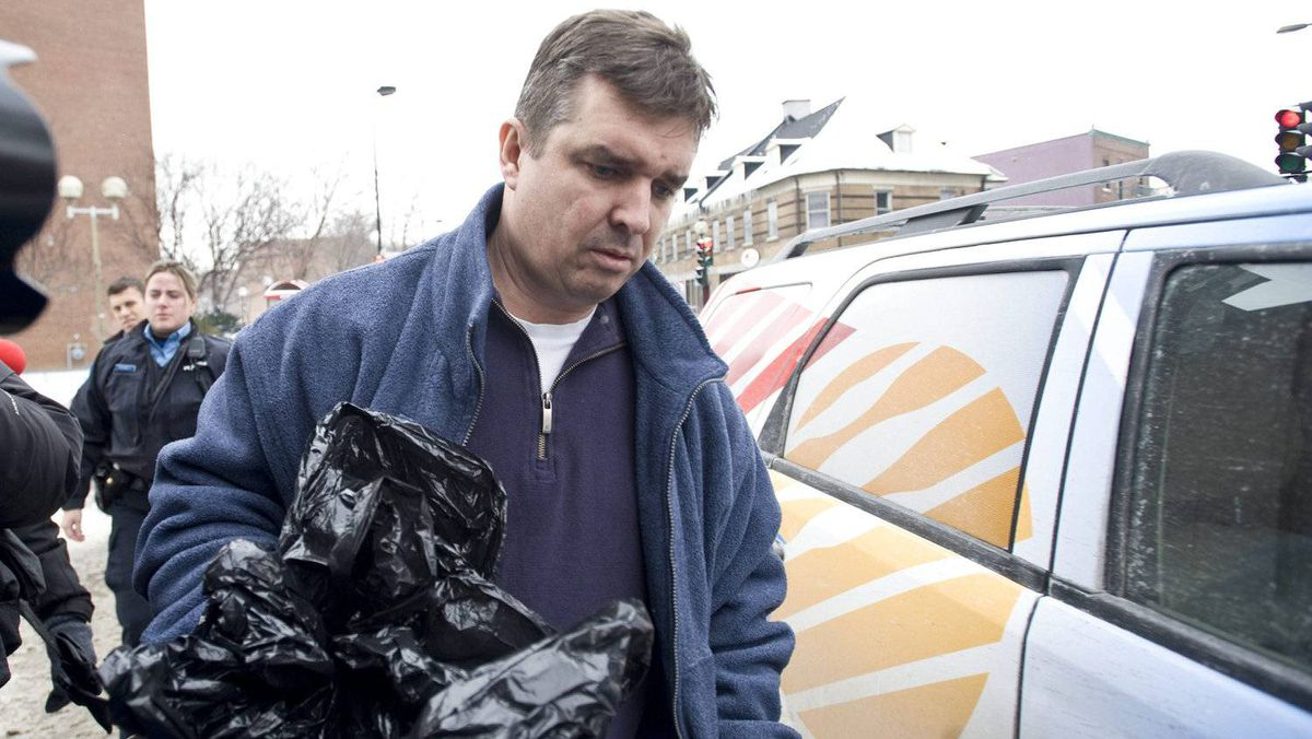 Former chief executive of the Norbourg investment company and convicted fraudster Vincent Lacroix arrives at a half-way house in Montreal Thursday, January 27, 2011 after being released from prison.