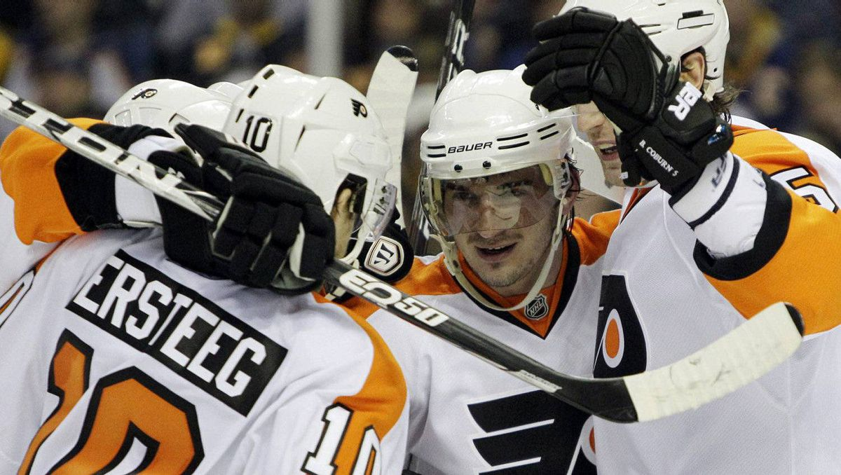 Philadelphia Flyers' Nikolay Zherdev, center, of Ukraine, celebrates his goal with teammates during the second period in Game 3 of a first-round NHL Stanley Cup playoffs hockey series against the Buffalo Sabres, in Buffalo, N.Y., Monday, April 18, 2011. The Flyers won 4-2. (AP Photo/David Duprey)