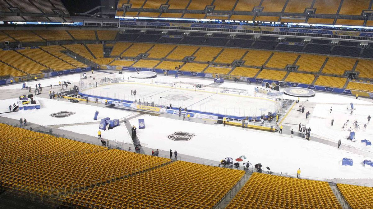 Crews do final preparations before fans are allowed into Heinz Field before the start of the NHL Winter Classic outdoor hockey game between the Pittsburgh Penguins and the Washington Capitals in Pittsburgh, on Saturday, Jan. 1, 2011. (AP Photo/Keith Srakocic)