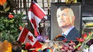 A portrait of the late NDP Leader Jack Layton sits in flowers at a makeshift memorial outside Toronto City Hall on Friday, Aug. 26, 2011.