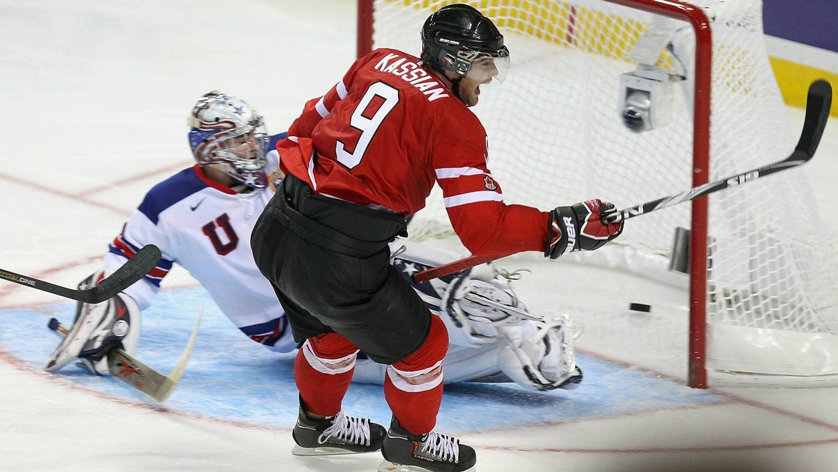 Zack Kassian of Canada scores Canada's fourth goal against Jack Campbell of the United States.
