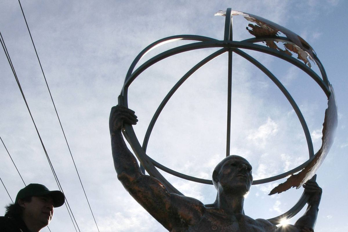 Atlas, an approximately 700 pound, $200,000.00 copper sculpture that was stolen from its perch high atop Highway 400 in Toronto, is put back in place in December of 2006.