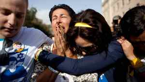 Supporters show their emotion as Noam and Aviva Shalit, parents of captured Israeli soldier Gilad Schalit, leave a protest tent set up outside the Prime Minister's residence on October 12, 2011 in Jerusalem, Israel. An agreement has been made between Israel and Hamas for a prisoner exchange where IDF soldier Gilad Shalit is returned for the release of over 1000 Palestinian prisoners.