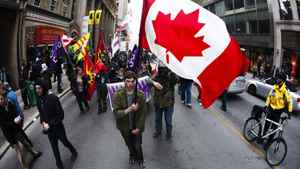 """Protesters march down Yonge Street during the """"Occupy Toronto"""" movement in Toronto, November 19, 2011."""